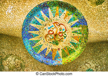 sun mosaic at the Parc Guell, Barcelona