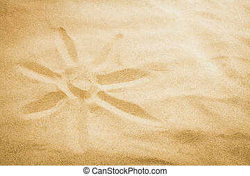 drew a sun with your finger on the sand in summer