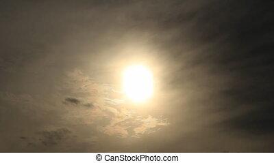 Sun on the moody sky