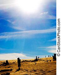 sun over a desert, pollution, dryness, evironment and war...