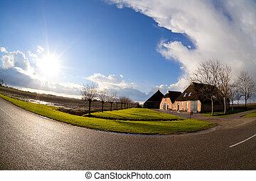 sun over Dutch farm house, fisheye view - bright sunbeams ...
