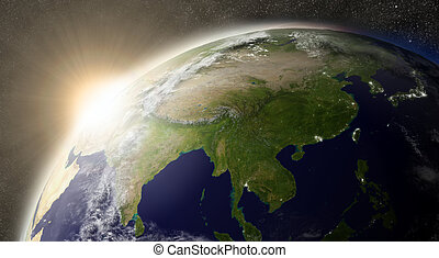 Sunset over East Asia region on planet Earth viewed from space with Sun and stars in the background. Elements of this image furnished by NASA.