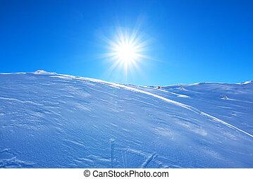 Sun over mountain snow cap shining bright