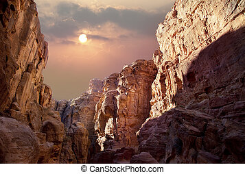 Sun over the canyon - Scenic view of canyon in Wadi Rum,...