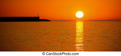 sun over the sea at sunset