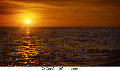 Sun over tropical ocean. Beautiful orange sunset