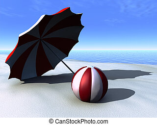 Sun parasol and beach ball on a beach.
