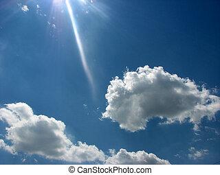 sun ray - cloudy sky background