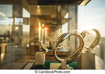 Sun ray on luxury watches displayed in shopwindow - Sun ray...