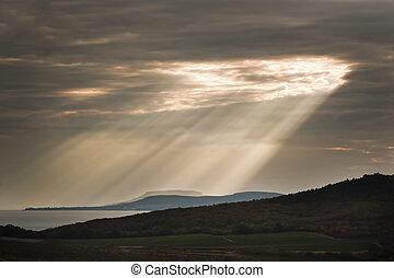Sun ray over lake