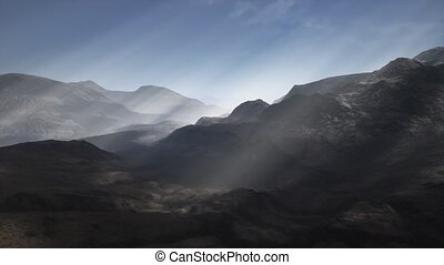 Sun Rays against the Backdrop of the Mountains - the sun's...
