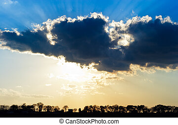 Sun Rays Beam through Dark Ominous Clouds with Silver Lining