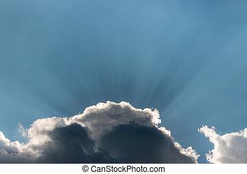 sun rays breaking through clouds