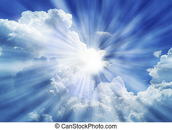 Dramatic blue sky with white clouds and sun rays.