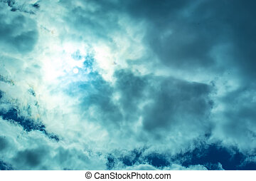Sun rays look through cumulus clouds. Abstract. Background.