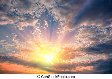 Sun rays look through dark clouds.