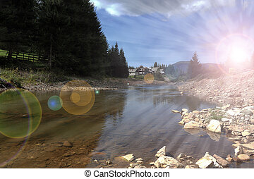 sun rays over mountain river