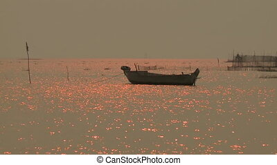 Sun rays reflecting in the river water - A hand held, medium...