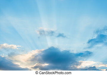 Sun rays shining through cloud