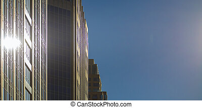 Sun reflected on the glass windows of a building