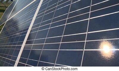 Sun reflection on solar panel. Sun collector farm in rural ...