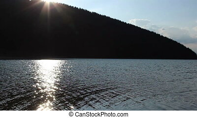 Sun Reflections on Lake Surface