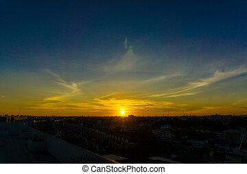 Sun rise beam over modern city of Bangkok