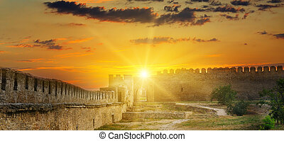 Sun rise over the fortress wall of a medieval fortress. Akkerman Ukraine.
