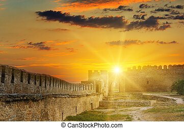 Sun rise over the fortress wall of a medieval fortress. Ukraine.
