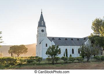 Sun rises behind the Dutch Reformed Church in Nieu-Bethesd