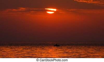sun rises over the sea early in the morning