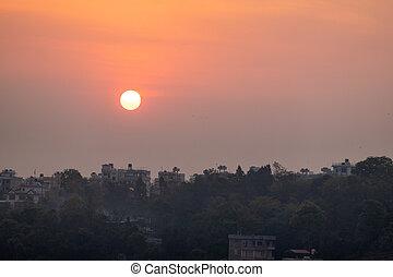Sun Rising Above the Houses in Kathmandu
