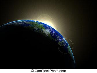 Sun rising against earth