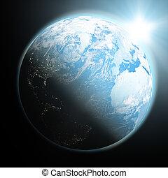 Sun rising over blue Earth