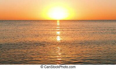 Sun Rising Over the Calm Sea
