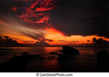 Sun rising. - Sun rising over water horizon at Teluk...