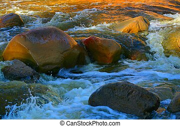 Sun Rocks - Rocks in stream running through a deep ravine...