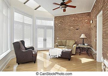 Sun room with brick wall - Sun room with windows and brick...