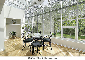 Sun room in luxury home with ceiling windows