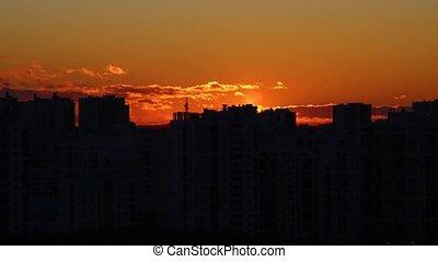 Sun setting down over a city