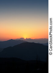 Sun setting over 3 valleys 1