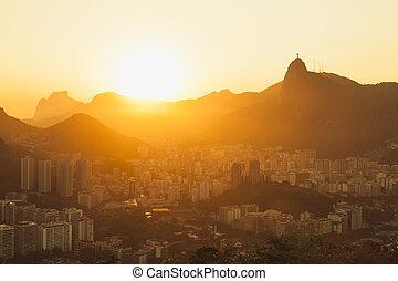 Sun setting over Rio cityscape