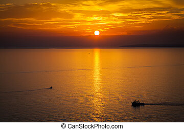 sun setting over the Mediterranean sea