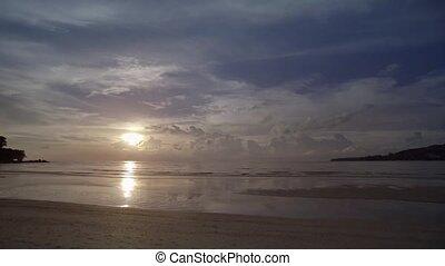 Sun setting over Tropical Beach Paradise in Phuket, Thailand...