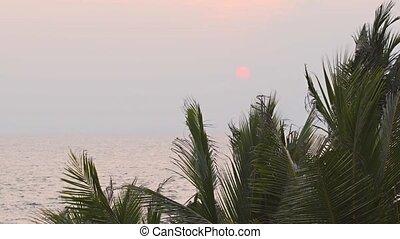 Sun Setting through the Haze over a Tropical Beach Paradise...