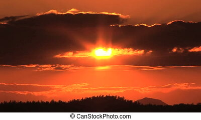 Sun setting, Time Lapse - Beautiful orange sunset, time...