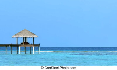 Sun Shelter on the End of a Pier at a Resort in the Maldives...