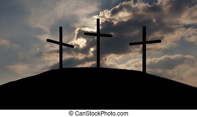 Sun Shines Behind Crosses On Hill