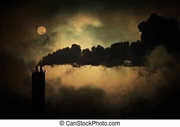 Sun shines through smoke from factory chimneys, telephoto...