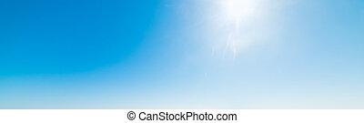 Sun shining in the blue sky